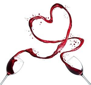 Glasses of red wine splashing