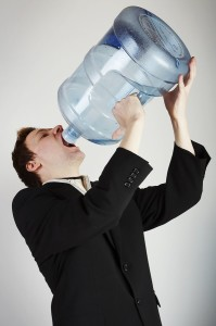 Man drinking water from huge bottle